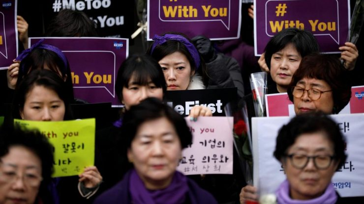 Women attend a protest as a part of the #MeToo movement on International Women's Day in Seoul, South Korea